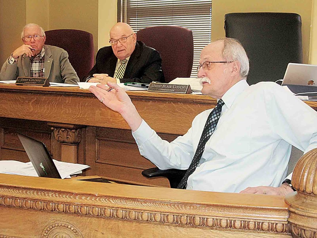 Photo by Evan Bevins Wood County Administrator Marty Seufer, right, speaks during Thursday's County Commission meeting as, from left, Commissioners Bob Tebay and Jimmy Colombo listen.