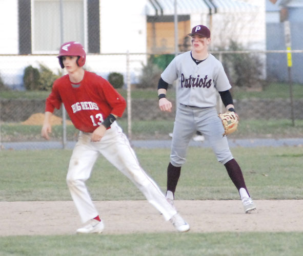Parkersburg High's Chad Conner (13) leads off of first base as George Washington first baseman Paul Boddy gets into fielding position during a high school baseball game Friday at Bennett Stump Field. Photo by Steve Hemmelgarn.