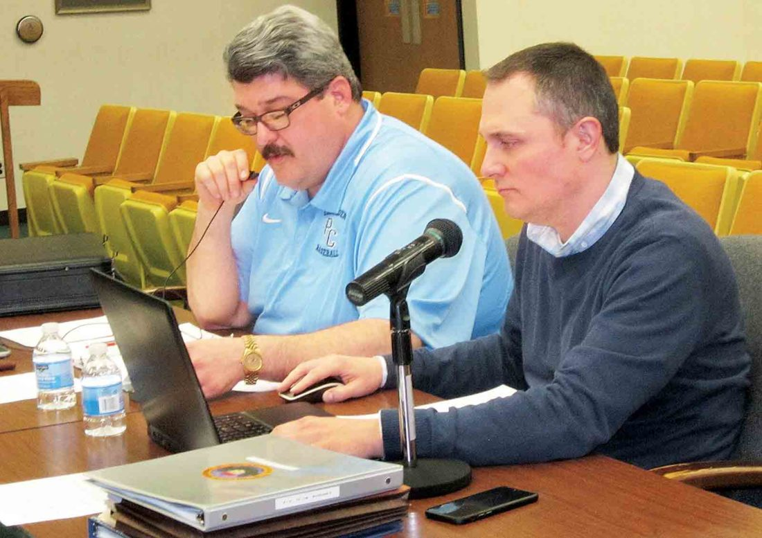 Photo by Wayne Towner Mayor Tom Joyce, left, and city Finance Director Eric Jiles discuss the proposed 2017-2018 budget for the city of Parkersburg with council members Friday during the final budget committee meeting held by Parkersburg City Council.