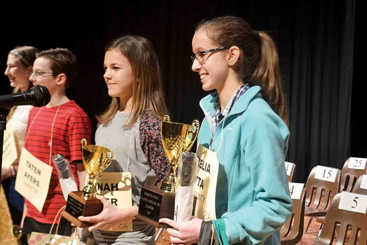 Photo by Peyton Neely Cecelia Fatta, 14, from Jackson Middle School, right, smiles as she wins the 37th annual Marietta Times Regional Spelling Bee on Friday night. Standing next to her is the runner-up, Hannah Archer, 14, from St. Mary School.