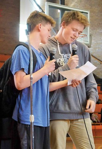 Photo by Peyton Neely Marietta Middle School eighth-graders John Bricker, 14, and Chase Buck, 14, perform stand-up comedy during the talent show on Friday.