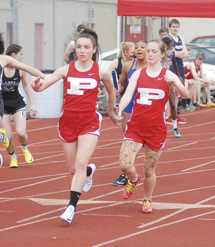 Parkersburg's Abby Tanner, left, takes the baton from teammate Alexa Kotarski during Saturday's 4x100 at the Kim Nutter Classic. The duo joined lead leg Samantha Williams and second leg Megan Kupfner to finish with a winning time of 53.50. Photo by Jay W. Bennett