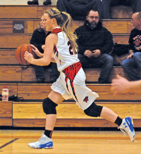 Wirt County senior Cori Hughes, pictured here in a game against Roane County this past season, has decided to continue her basketball career for the Bethany College Bison. Photo by Jay W. Bennett.