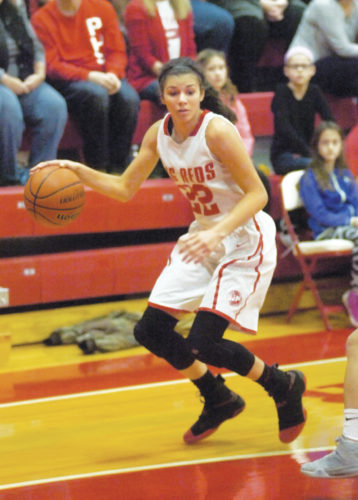 Parkersburg's Shay-Lee Kirby plots her next move against Spring Valley during the Big Reds' Class AAA Region IV co-final victory over the Timberwolves during the 2016-17 postseason. Photo by Joe Albright.