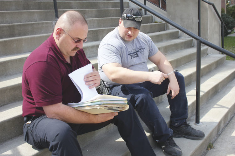 Photo by Janelle Patterson Marietta Police Chief Rodney Hupp, left, and Capt. Aaron Nedeff review old files to be destroyed.