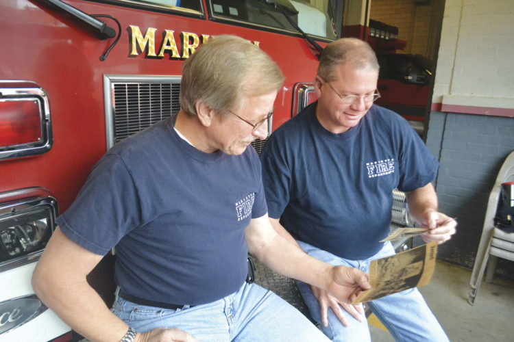 Photo by Peyton Neely Marietta firefighters Jack Hansis and Tim Casto reflect on some of their first runs together that resulted in stories in The Marietta Times in 1988.