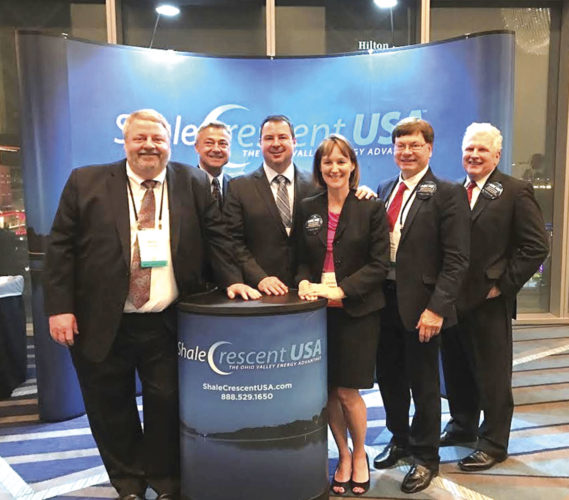Photo Provided Representatives of Shale Crescent USA attended the World Petrochemical Conference March 20 in Houston. Standing in front of its display are, from left, Wally Kandel, Mark Schwendeman, Brian Chavez, Christy Chavez, Greg Kozera and Jerry James, members of the Shale Crescent board of directors, except for Kozera, who is director of marketing.