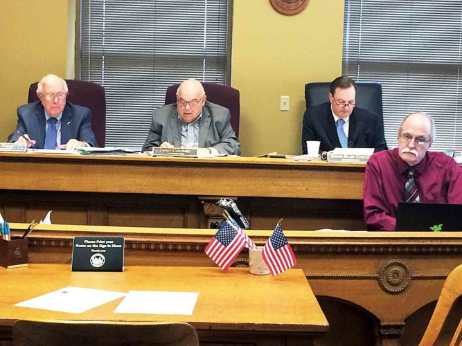 Wood County Commissioners Bob Tebay, Jimmy Colombo and Blair Couch approved the county's $21.55 million budget for the 2017-18 fiscal year. (Photo by Brett Dunlap)