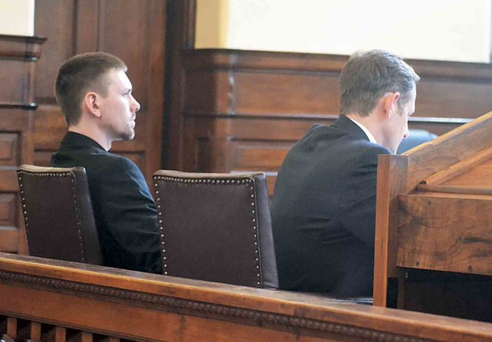 Warren Township resident Ryan Vogt, left, listens to the audio recording of the interview between him and Det. Lt. Bryan Lockhart during day two of his trial in Judge Randall Burnworth's courtroom on Tuesday. At his right is defense attorney Rolf Baumgartel. (Photo by Peyton Neely)