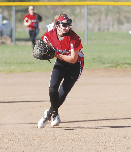 Parkersburg High School third baseman Katie Hudkins scoops up a grounder hit by Parkersburg South's Alexis Feick during Wednesday's game at Godbey Field. PHS won 12-4 in five innings. Photo by Jay W. Bennett.