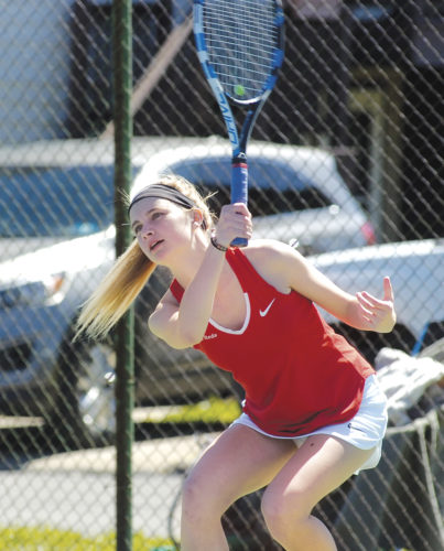 Parkersburg High's Lauren Kruger returns a shot during her No. 2 doubles match with partner Bairavi Sundaram against Morgantown Saturday at the City Park tennis courts. Photo by Joe Albright.
