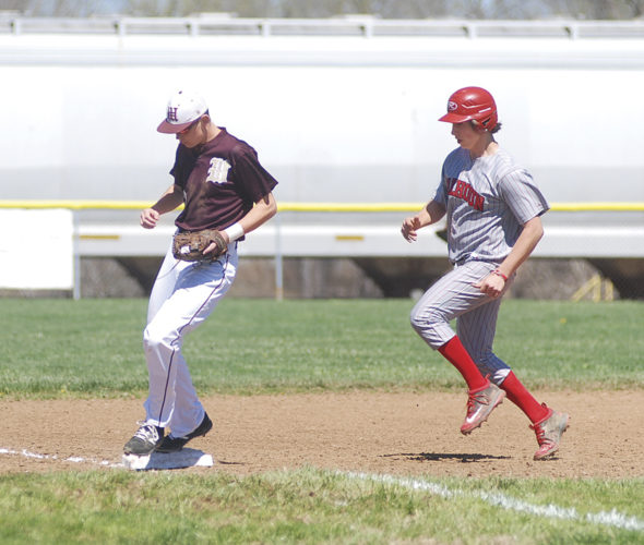 Williamstown's Brayden Mullenix beats Calhoun County's Caden Hicks to third base for a force out during the first game of Saturday's twinbill. Photo by Jay W. Bennett.