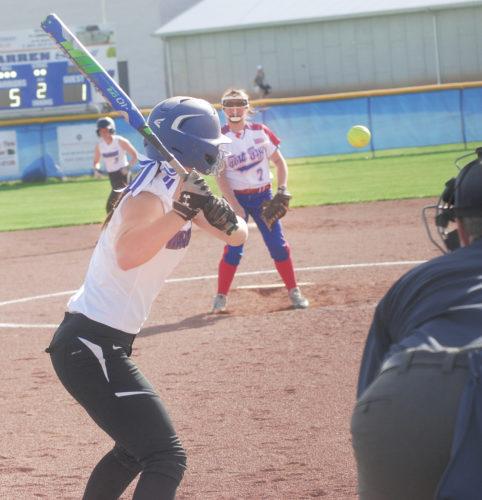 Photos by Jordan Holland Warren's Diamond Decker takes a pitch from Fort Frye hurler Jada Baker during a high school softball game Monday in Vincent.