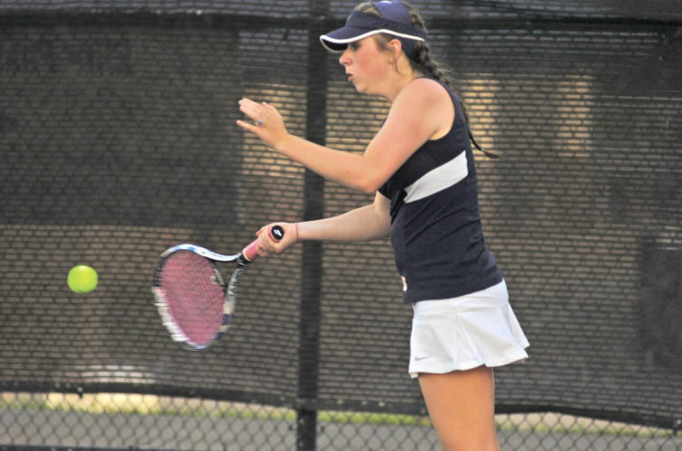 Parkersburg South's Jordan Mader returns a service shot in her singles match against Ripley's Mary Pierson Wednesday at the Erickson All-Sports Facility. Photo by Joe Albright.