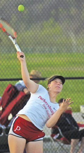 Parkersburg's Alex Olson serves during her No. 1 doubles matchup with partner Ashley Casto against Parkersburg South's Katie Athey and Jordan Mader Wednesday at Erickson All-Sports Facility. Photo by Joe Albright.