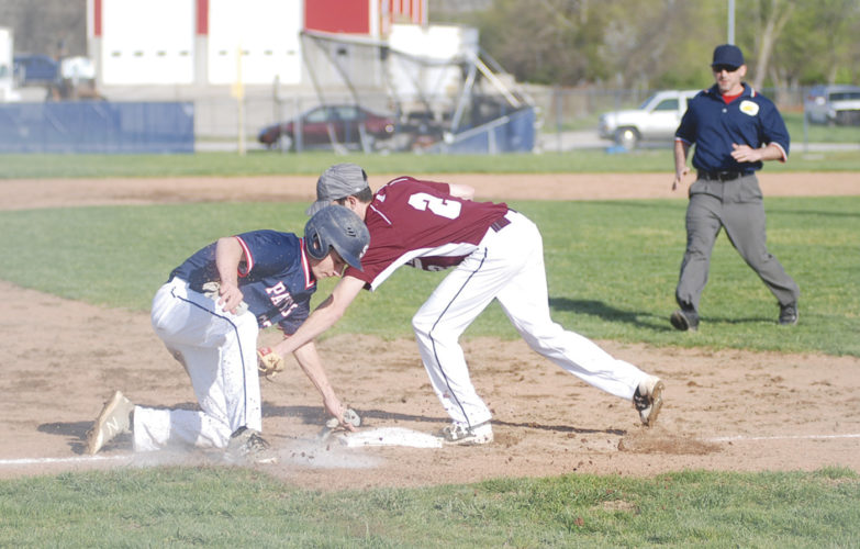 Parkersburg South's Todd Burner makes it to third on a wild pitch just before Roane County's Alex Reynolds can apply the tag during the Patriots' 11-4 win on Wednesday at Hank Greenburg Field. Photo by Jay W. Bennett.