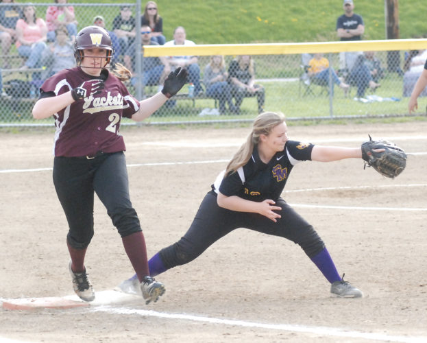 Williamstown's Kristin Harmon, left, crosses first base safely as St. Marys' Dixie Price stretches for a throw during a high school softball game Thursday in Williamstown. Photo by Jordan Holland.