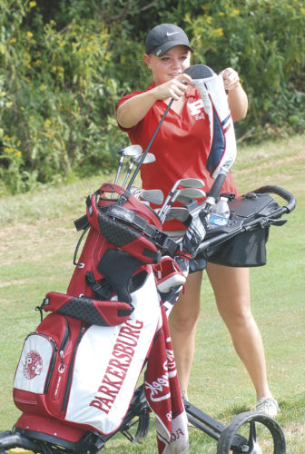 Parkersburg golfer Whitney Milhoan packs up her clubs during a high school golf match last season. Photo by Joe Albright.