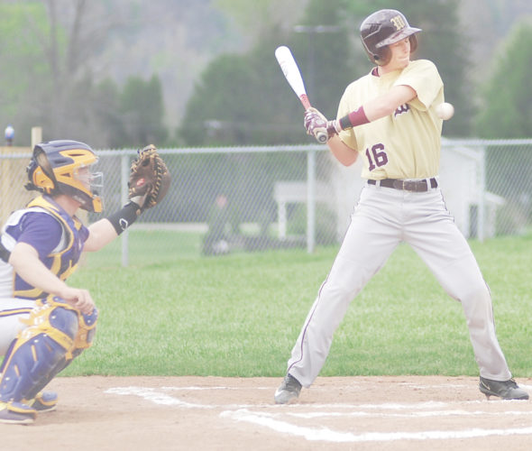 Photo by Jay W. Bennett Williamstown leadoff hitter Bryce Haer grimaces before taking one for the team in the top of the first inning during the Yellowjackets' 18-4 five-inning mercy rule victory Friday at St. Marys.
