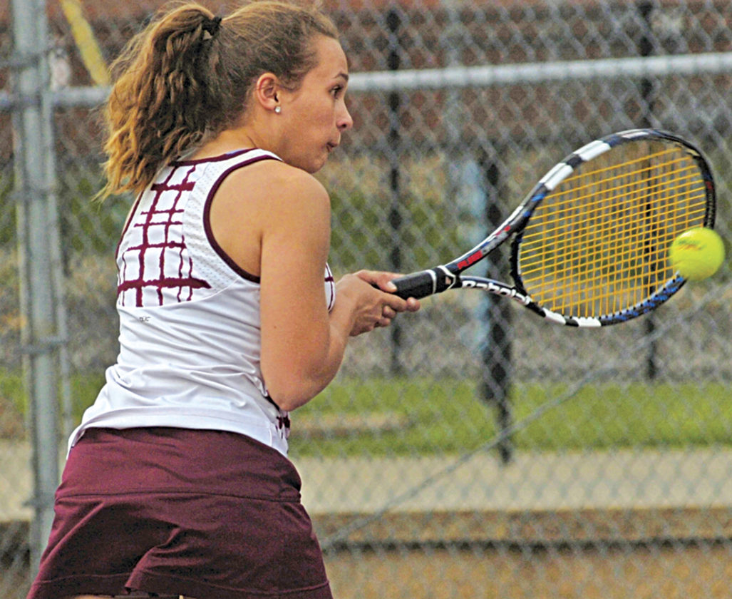 Yellowjackets' No. 3 girls' singles player India Flores concentrates on her next shot to John Marshall's McKenzie Whorton during the Yellowjackets' default victory. Photo by Joe Albright.