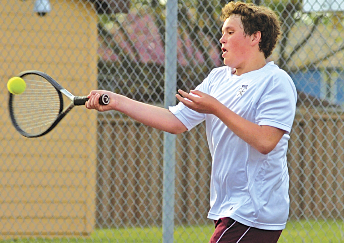 Williamstown High's Jimmy Fauber returns a rally shot from John Marshall No. 3 singles player Brian Kotson during his 8-4 victory Wednesday at Williamstown tennis courts. Photo by Joe Albright.