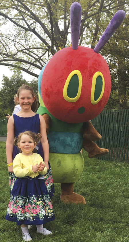 Photo Provided Madeline and McKenzie Lore of Parkersburg pose with the storybook character The Very Hungry Caterpillar  during the White House's Easter Egg Roll on Monday in Washington, D.C.