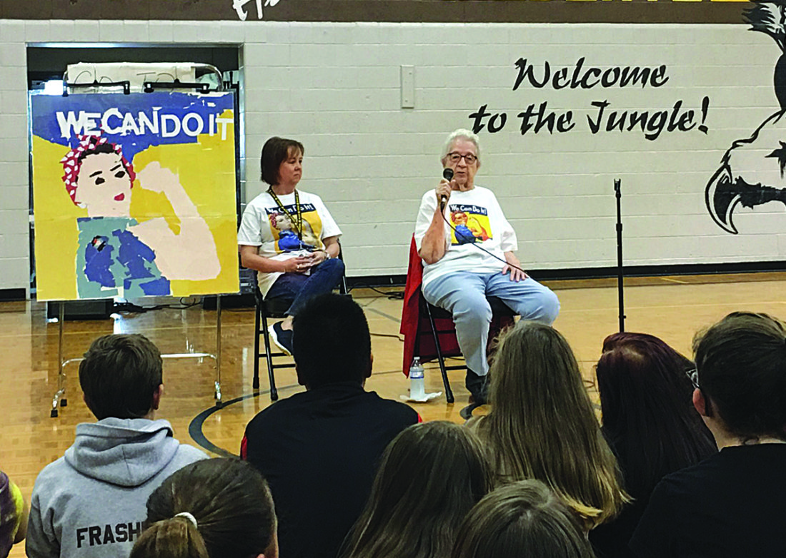 """Photo by Michael Erb Hamilton Middle School teacher Jennifer Furner, left, listens along with students to stories told by Marietta resident Neva Rees, who worked as a """"Rosie the Riveter"""" during World War II."""