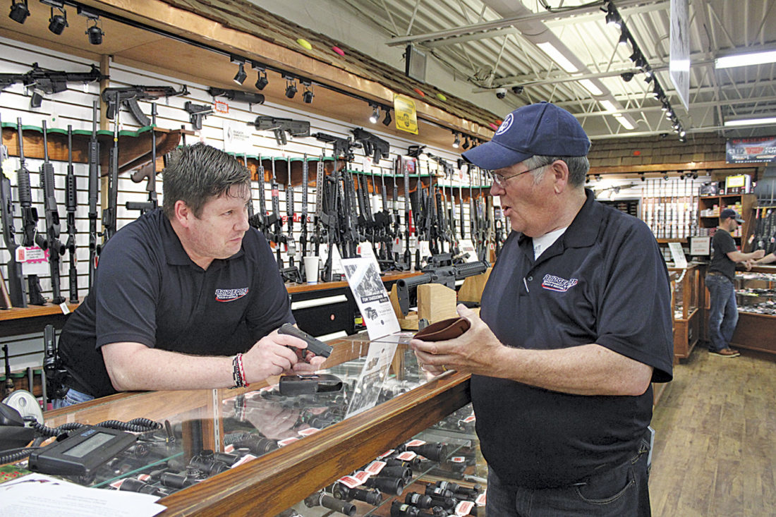 officials discuss ohio s changing gun laws news sports jobs photo by janelle patterson gun s associate craig sturm left and gun deck manager