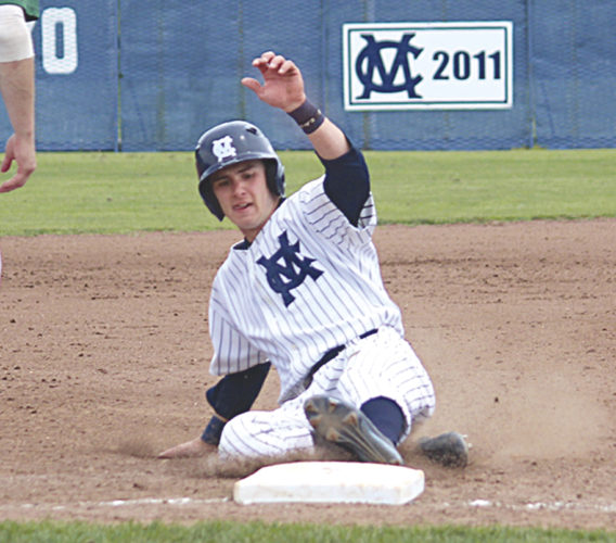 Marietta College's Michael Barnabei slides in to home plate during the team's doubleheader  sweep Sunday against Wilmington College in Marietta. Photo courtesy of France Moise.