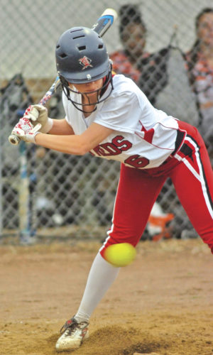 Parkersburg High's Alyssa Gates watches a pitch zoom past her while at bat during the Big Reds' 6-1 Senior Day win over South Charleston. Photo by Joe Albright.