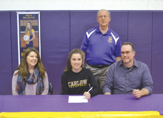 Wood County Christian School's Hannah Riggs, center sitting, signs a National Letter of Intent to continue her education and play volleyball at Carlow University in Pittsburgh, Pa. Left to right, sitting: Taffy Riggs (mother), Hannah, and Jason Riggs (father). Standing is WCCS volleyball coach Mike Conaway. Photo by Ron Johnston.