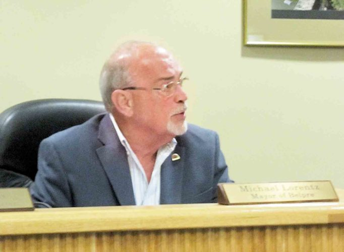 Belpre Mayor Mike Lorentz gives a report at Monday's meeting of Belpre City Council, including several ribbon cuttings and groundbreakings planned over the next few weeks in Belpre. (Photo by Wayne Towner)