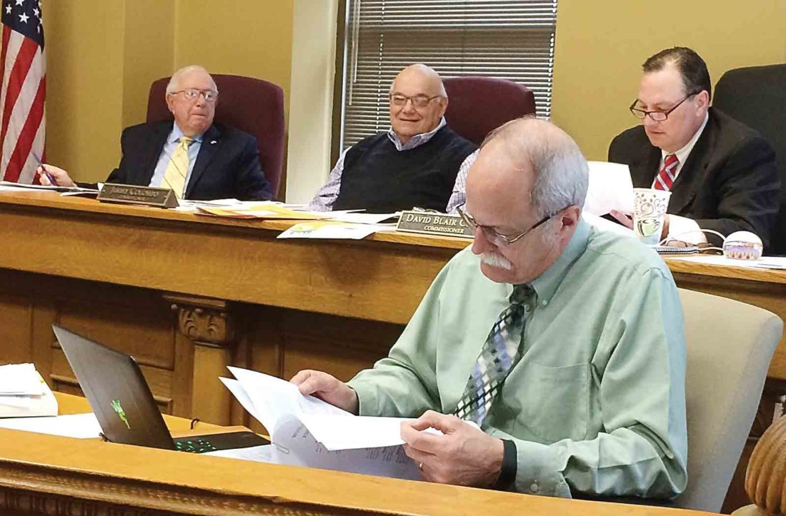 Wood County Commissioners Bob Tebay, Jimmy Colombo and Blair Couch, along with Wood County Administrator Marty Seufer, discussed changes to the County Fire Fee at Monday's meeting. (Photo by Brett Dunlap)