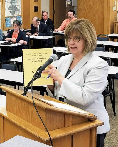 Wood County Schools Finance Director Connie Roberts presents a draft 2018 budget Tuesday to the Wood County Board of Education. The board also approved the sale of $41 million in bonds, which will be used for construction projects throughout the district. (Photo by Michael Erb)
