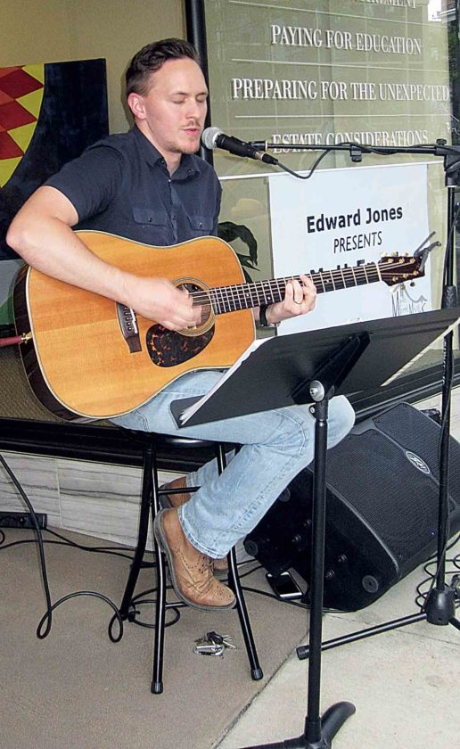 Photo by Wayne Towner Musician Matt Enik performs Friday at the office of Edward Jones Financial Advisor J.C. Rutter.