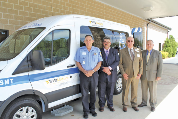 Photo Provided Camden Clark Medical Center purchased this specialized medical transport van with the $75,000 gift from the Auxiliary which will be used to transport patients from the hospital. Pictured from left are Ambulance Service Director Larry Stephens, Parkersburg Mayor Tom Joyce, Auxiliary President Mark Jenkins and CCMC President and CEO David McClure.