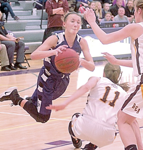 Staff photo by Steve Muscatello New Ulm's Joey Batt looks to make a pass after colliding with Blue Earth Area defender Caitlin Rorman (11)Thursday at NUHS.  For more photos of this event go to cu.nujournal.com