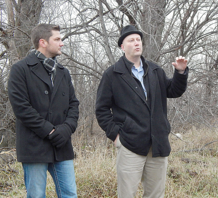 "Staff photo by Fritz Busch Clements farmer Alex Petersen, left, and former Minnesota House Republican Minority Leader Marty Seifert speak at the site of a gruesome ax murder that occurred on a farm near Clements in 1917. Seifert's new historical fiction book about the event, ""Sundown at Sunrise"" is set to be released later this month."