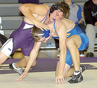 Staff photo by Steve Muscatello New Ulm Area's Lane Miller wrestles Blake Wendland of Waseca at 152 pounds Tuesday at New Ulm High School. For more photos of this event go to cu.nujournal.com