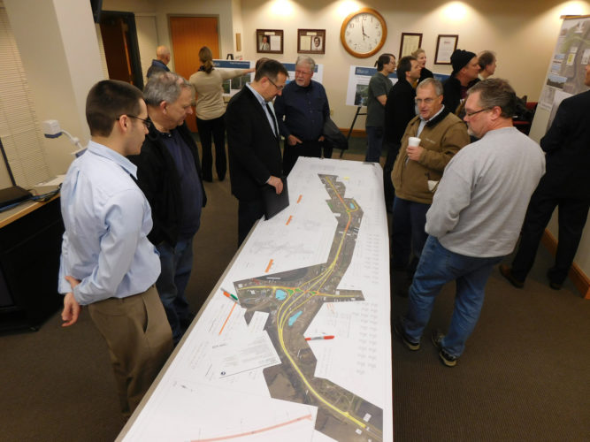 Staff photo by Clay Schuldt  New Ulm residents reviewed Minnesota Department of Transportation (MnDOT) plans for the Highway 14/15 interchange, during a special open house before Tuesday's City Council meeting. The council approved the final layout during the meeting.