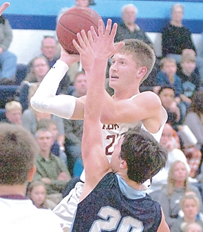Staff photo by Steve Muscatello Wabasso's Tony Franta takes a shot as Matthew Munsen (20) of Minnesota Valley Lutheran defends on the play Tuesday at MVL. For more photos of this event go to cu.nujournal.com