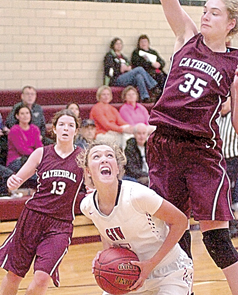 Staff photo by Steve Muscatello Gibbon-Fairfax-Winthrop's Erin Haas looks to shot as New Ulm Cathedral's Becca Schwarz (35) defends on the play during the second half Tuesday at CHS. Looking on is the Greyhounds' Jenna Helget (13). For more photos of this event go to cu.nujournal.com
