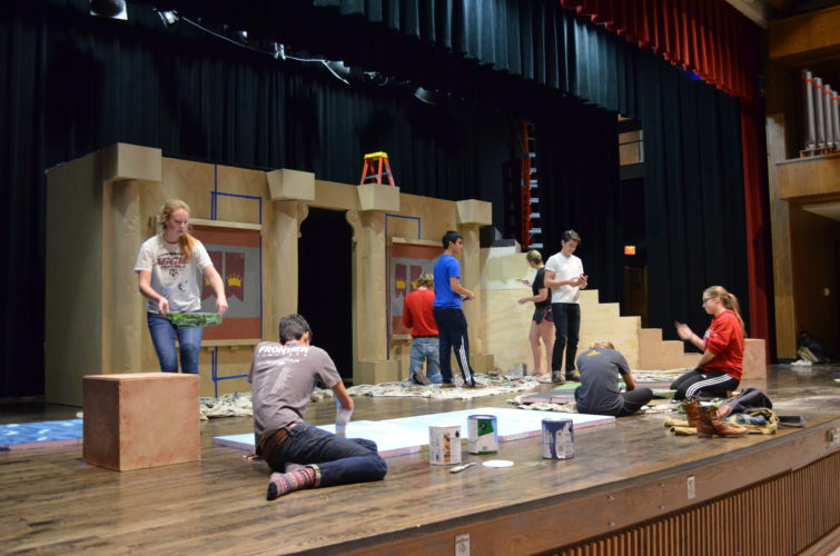 Staff photo by Connor Cummiskey  The Martin Luther College Reader's Theater crew works hard to finish a stage building called a skene for a show that opens Friday, Dec. 9.