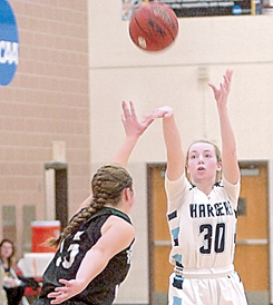 Staff photo by Steve Muscatello Minnesota Valley Lutheran's Maddie Spurgin (30) takes a shot over Lisa Hoffer of West Lutheran at the Lutheran Tip-Off Tournament Friday at Martin  Luther College in New Ulm. For more photos of this event go to cu.nujournal.com