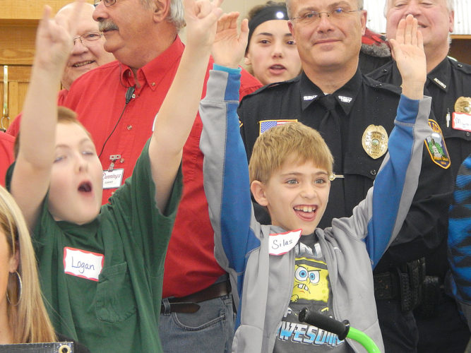 """Staff photo by Fritz Busch Two of the youngsters in the """"Shop With a Hero"""" event at Runnings store show their excitement Saturday after receiving bicycles in the annual program. For more photos see page 8A."""