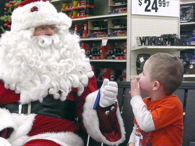 Rylan Barthel, 4, of New Ulm, tells Santa Claus what he wants for Christmas.