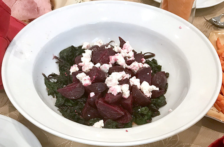 Beets, served with their own greens and feta cheese.