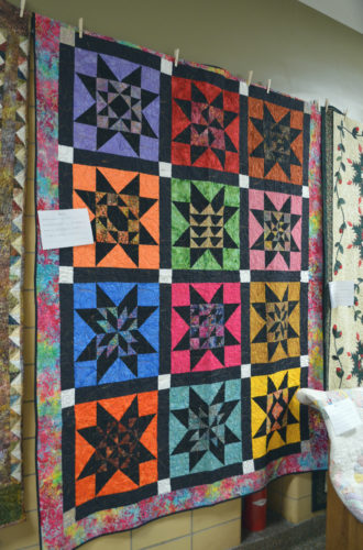 "This quilt was made by Michelle Luther last year and given to one of her grandchildren. The ""quilt's story"" written on the attached note states that the back is as beautiful as the front."