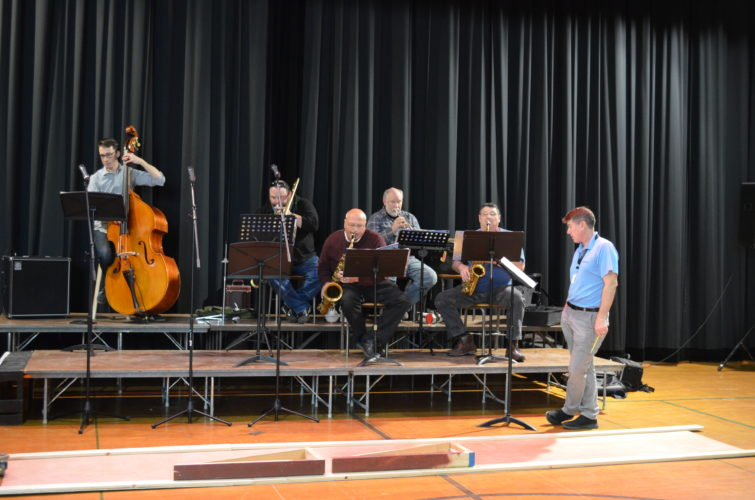 "Staff photo by Connor Cummiskey  A jazz band rehearses for a show Jan. 20-21 at State Street Theater called ""Frank Sinatra and Friends: A Crooners Tribute."" The band is under the direction of Kent Menzel (far left). Pictured from left to right: Eric Zimmerman on string bass, Dave Stordalen on trombone, Frank Cesario on tenor saxophone, Thomas Bierer on trumpet and Stephen Elfstrand on alto and bari saxophone. Not pictured: Roger Lindholm on piano and Justin Tollefson on drums."