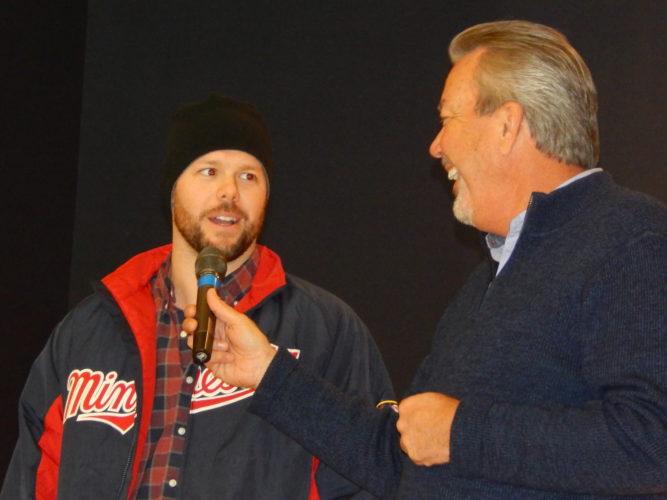 Staff photo by Fritz Busch Minnesota Twins broadcaster Dick Bremer, right, enjoys a lighter moment as he interviews Twins pitcher Ryan Pressly at the Minnesota Twins Winter Caravan stop at the New Ulm Community Center on Monday.